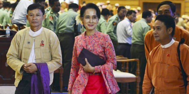 Myanmar opposition leader Aung San Suu Kyi, center, walks along with other lawmakers of her National League for Democracy party as they leave after a regular session of the lower house of parliament Monday, Feb 1, 2016 in Naypyitaw, Myanmar. Myanmar's parliament, dominated by Suu Kyi's party, on Monday began a new and historic session that will install the country's first democratically elected government in more than 50 years. (AP Photo/Aung Shine Oo)