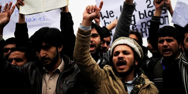 PAKHTUNKHWA, PAKISTAN - JANUARY 25: Pakistani students chant slogans against Taliban during the protest against the Security weakness in Bacha Khan University at Charsadda town of Pakhtunkhwa province in Pakistan on January 25, 2016. 21 students are dead after Taliban gunmen attacked Bacha Khan University. (Photo by Metin Aktas/Anadolu Agency/Getty Images)