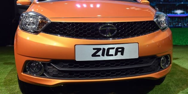 Tata Motors' new hatchback car 'Zica' is seen at the Indian Auto Expo 2016 in Greater Noida on the outskirts of New Delhi on February 3, 2016. India's flagship auto show opened its doors in New Delhi February 3, with a new batch of diesel-guzzling SUVs on proud display despite industry uncertainty over a pollution crackdown targetting motorists in the capital. India's biggest carmaker Tata Motors said February 2 it would rename its new Zica hatchback as global alarm grows over an outbreak of the identical-sounding Zika virus.   AFP PHOTO / PRAKASH SINGH / AFP / PRAKASH SINGH        (Photo credit should read PRAKASH SINGH/AFP/Getty Images)