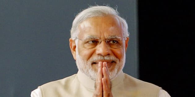 Indian Prime Minister Narendra Modi greets the audience as he arrives to inaugurate the International Conference on Frontiers in Yoga Research and its Applications in Jigani, near Bangalore, India, Sunday, Jan. 3, 2016. The conference aims to make an effort to integrate Ayurveda, Naturopathy, Yoga, Unani, Siddha, Homeopathy and modern medicine by bringing prominent researchers and doctors from all these fields on one platform. (AP Photo/Aijaz Rahi)