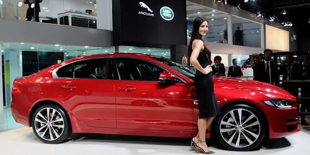 DELHI, INDIA - FEBRUARY 3: Bollywood actress Katrina Kaif poses with the Jaguar XE during its launch at the Indian Auto Expo in Greater Noida, on the outskirts of  Delhi , February 03, 2016. (Photo by Imtiyaz Khan/Anadolu Agency/Getty Images)