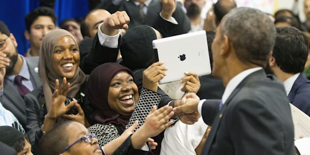 President Barack Obama greets children from Al-Rahmah school and other guests during his visit to the Islamic Society of Baltimore, Wednesday, Feb. 3, 2016, in Baltimore, Md. Obama is making his first visit to a U.S. mosque at a time Muslim-Americans say they're confronting increasing levels of bias in speech and deeds.(AP Photo/Pablo Martinez Monsivais)