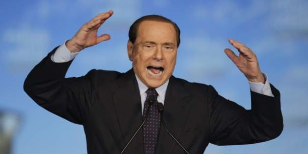 """FILE - In this Oct. 3, 2010 file photo, Italian Premier and People of Freedom (PDL) party leader Silvio Berlusconi delivers his speech on the occasion of a party rally, in Milan, Italy. A furious Silvio Berlusconi called into a TV show Monday, Jan. 24, 2011, discussing his alleged prostitution scandal, traded insults with the host and said the program was like a """"brothel.'' His supporters said Tuesday that the Italian premier had a right to defend himself from accusations made during the show. Critics said the call was a show of aggression from an increasingly desperate man. (AP Photo/Luca Bruno, File)"""