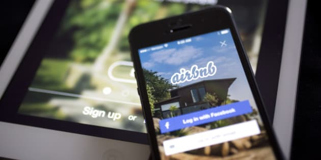 The Airbnb Inc. application is displayed on an Apple Inc. iPhone and iPad in this arranged photograph in Washington, D.C., U.S., on Friday, March 21, 2014. Airbnb Inc. is raising money from investors including TPG Capital in a financing round that would value the room-sharing service at more than $10 billion, said people with knowledge of the deal. Photographer: Andrew Harrer/Bloomberg via Getty Images