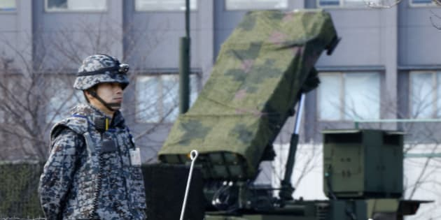 A Japan Self-Defense Force member stands by a PAC-3 Patriot missile unit deployed for North Korea's rocket launch at the Defense Ministry in Tokyo, Sunday, Jan. 31, 2016. Japan's Defense Ministry installed missile interceptors at their headquarters in central Tokyo on Friday amid signs that North Korea may be preparing to launch a rocket or missile. (AP Photo/Shizuo Kambayashi)