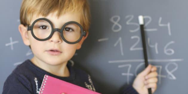 Little boy playing teacher at home