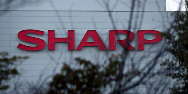 The Sharp Corp. logo is displayed at the company's Kameyama plant in Kameyama City, Mie Prefecture, Japan, on Wednesday, Oct. 3, 2012. Last month, Sharp said it had pledged the Kameyama plant as collateral along with most of its properties, including the company headquarters in Osaka, in return for 360 billion yen ($4.6 billion) in loans to stay afloat. Photographer: Yuzuru Yoshikawa/Bloomberg via Getty Images