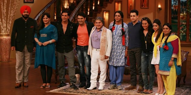 MUMBAI, INDIA AUGUST 01 - Akshay Kumar, Imran Khan and Sonakshi Sinha with Kapil Sharma, Sumona Chakravarti, Ali Asghar, Sunil Grover, Upasna Singh, Naseem Vicky, Navjot Singh Siddhu and Soni Singh on the sets of Comedy Nights with Kapil for the promotion of Once Upon a Time in Mumbaai 2 on 1st August, 2013 in Mumbai.(Photo by Milind Shelte/India Today Group/Getty Images)