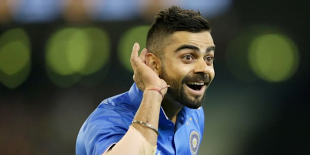 MELBOURNE, AUSTRALIA - JANUARY 29:  Virat Kohli of India gestures to Australian fans after India took the wicket of Glenn Maxwell of Australia during the International Twenty20 match between Australia and India at Melbourne Cricket Ground on January 29, 2016 in Melbourne, Australia.  (Photo by Darrian Traynor - CA/Cricket Australia/Getty Images)