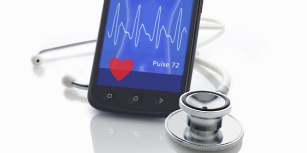 Mobile smart-phone as a medic monitor with a stethoscope. Graphics on the display are part of the image copyright.