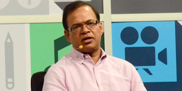 AUSTIN, TX - MARCH 10:  Amit Singhal, SVP and software engineer at Google Inc. speaks onstage at the Andy Rubin conversation with Guy Kawasaki during the 2013 SXSW Music, Film + Interactive Festival at Austin Convention Center on March 10, 2013 in Austin, Texas.  (Photo by Amy E. Price/Getty Images for SXSW)