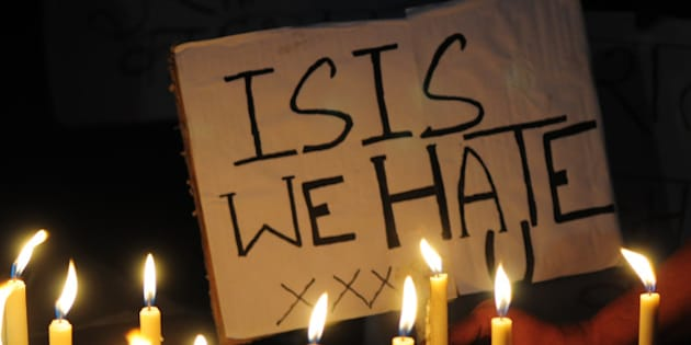 BHOPAL, INDIA - NOVEMBER 15: A Muslim kid holds a placard with slogan against the ISIS during a candle light vigil to express solidarity with the victims of Paris terror attacks on November 15, 2015 in Bhopal, India. At least 129 people lost their lives in terror attacks by terrorists in Paris at the packed Bataclan concert hall, restaurants and bars, and outside the Stade de France national stadium. The Islamist jihadist group IS, that has seized control of large parts of Syria and Iraq, claimed responsibility for the attacks. (Photo by Mujeeb Faruqui/Hindustan Times via Getty Images)