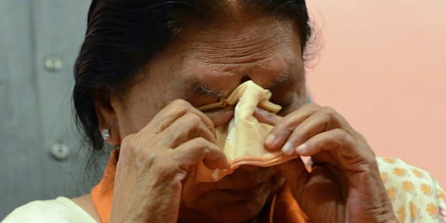 Gujarat's first woman chief minister, Anandiben Patel gets emotional during a meeting at the Town Hall in Gandhinagar, some 30 kms from Ahmedabad on May 21, 2014.   Anandiben Patel was termed as the new Gujarat chief minister and will take the oath on May 22 in Gandhinagar.  AFP PHOTO / Sam PANTHAKY        (Photo credit should read SAM PANTHAKY/AFP/Getty Images)