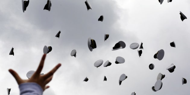 Graduating U.S. Naval Academy Midshipmen throw their hats into the air to cap off their graduation and commissioning ceremonies, Friday, May 24, 2013, in Annapolis, Md. President Barack Obama urged new graduates to exhibit honor and courage in tackling incidents of sexual assault as they assume leadership positions in the military. (AP Photo/Patrick Semansky)