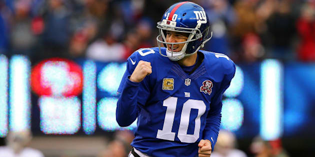 EAST RUTHERFORD, NJ - NOVEMBER 16:   Eli Manning #10 of the New York Giants celebrates after throwing a touchdown in the first quarter against the San Francisco 49ers at MetLife Stadium on November 16, 2014 in East Rutherford, New Jersey.  (Photo by Elsa/Getty Images)