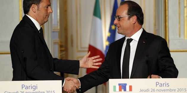 France's President Francois Hollande, right, shakes hand with Italian Premier Matteo Renzi following their joint press conference held at the Elysee Palace in Paris, Thursday, Nov. 26, 2015. Renzi's visit to Paris is part of president Hollande's diplomatic offensive to get the international community to bolster the campaign against the Islamic State militants. (AP Photo/Michel Euler)
