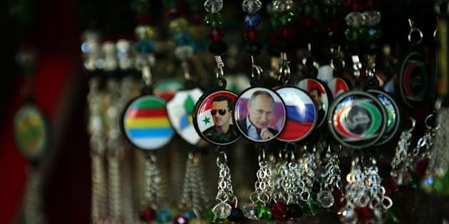 Key-rings bearing portraits of Syrian President Bashar al-Assad (L) and his Russian counterpart Vladimir Putin (C) are displayed at a handicrafts shop in the Syrian capital, Damascus, on February 4, 2016.  Syrian government troops moved closer to encircling rebels in the country's second city Aleppo, threatening a total siege after cutting their main supply line.  / AFP / JOSEPH EID        (Photo credit should read JOSEPH EID/AFP/Getty Images)