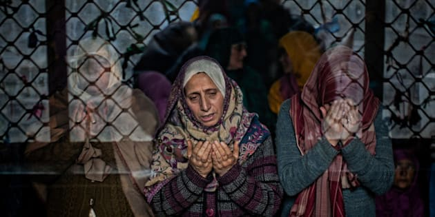 SRINAGAR, KASHMIR, INDIA - DECEMBER 07: Kashmiri Muslim women devotees pray at the shrine of the Sufi saint Sheikh Hamza Makhdoom during a festival on December 07, 2015 in Srinagar, the summer capital of Indian administered Kashmir, India. Thousands of Kashmiri Muslims make the pilgrimage to the shrine of Sufi Saint Sheikh Hamza Makhdoomi, also known as Makhdoom Sahib, to offer prayers on the anniversary of his birth. (Photo by Yawar Nazir/Getty Images)