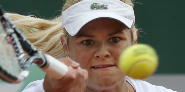 Canada's Aleksandra Wozniak returns the ball during the first round match of the French Open tennis tournament against Romania's Sorana Cirstea at the Roland Garros stadium, in Paris, France, Tuesday, May 27, 2014. (AP Photo/Michel Euler)