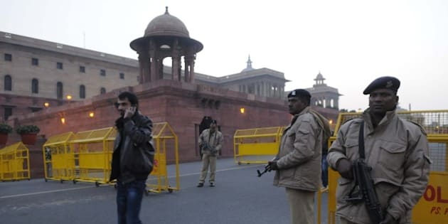 NEW DELHI, INDIA - JANUARY 3: Delhi Police and CRPF security personnel alert at Raisina Hill after authorities received a bomb threat after the fresh firing and bomb explosion inside the Pathankot Air Base, on January 3, 2016 in New Delhi, India. Security across the capital was beefed up after the fresh firing and bomb explosion inside the Pathankot Air Base. The deadly assault on an Indian air base near the Pakistan border was 'a heinous' terrorist attack, the United States said, urging the two rivals to work together to hunt down those responsible. Three security officers were killed in the attack by suspected Islamist militants on Pathankot base in northern Punjab state early January 2. So far, six terrorists and seven soldiers, including a Lieutenant colonel, have been killed in the exchange of fire. Five members of the Defence Security Corps succumbed to injuries in the hospital. The attackers were believed to have infiltrated from Pakistan and there was speculation that they may belong to Jaish-e-Mohammad headed by Maulana Masood Azhar of the Kandahar hijack episode. (Photo by Sonu Mehta/Hindustan Times via Getty Images)