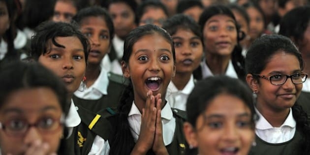 Indian schoolchildren react after watching a tiger on a giant screen during a 'Kids for Tigers' programme on the eve of World Tiger Day at Hyderabad Public School in Hyderabad on July 28, 2015.  World Tiger Day, is an annual celebration to raise awareness aimed at educating children about tiger conservation, held annually on July 29.  AFP PHOTO/NOAH SEELAM / AFP / NOAH SEELAM        (Photo credit should read NOAH SEELAM/AFP/Getty Images)