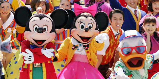Mickey, Minnie Mouse and Donald Duck dance on 60s rock and roll music for the new attraction 'Disney Rock Around the Mouse' at the Tokyo Disneyland during a preview, 14 April 2005.  Disney's theme land will start the new dance event from 15 April on the park's 22nd anniversary day.   AFP PHOTO/Yoshikazu TSUNO (Photo credit should read YOSHIKAZU TSUNO/AFP/Getty Images)