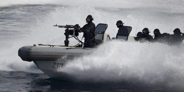 Indian naval commandos show their prowess during the International Fleet Review in Vishakapatnam, India, Saturday, Feb. 6, 2016. Indian President Pranab Mukherjee, who is the supreme commander of the Indian armed forces, reviewed a fleet of over 90 naval ships including several from foreign countries.  (AP Photo/Saurabh Das)