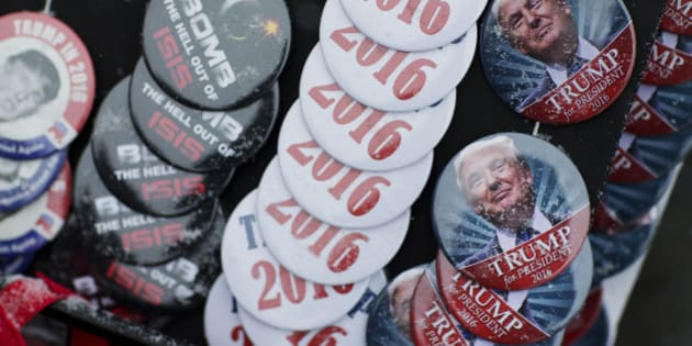 Snow collects on buttons for sale outside a campaign event for Republican presidential candidate Donald Trump at the Londonderry Lions Club Monday, Feb. 8, 2016, in Londonderry, N.H. (AP Photo/David Goldman)
