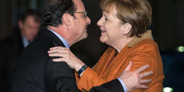 French president Francois Hollande, left, welcomes German Chancellor Angela Merkel upon her arrival in Strasbourg, eastern France, Sunday, Feb.7, 2016. (Patrick Seeger/Pool Photo via AP)