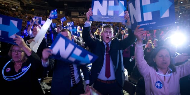 Supporters cheer as Democratic presidential candidate Hillary Clinton speaks at the New Hampshire Democratic Party McIntyre-Shaheen 100 Club Celebration dinner Friday, Feb. 5, 2016, in Manchester, N.H. (AP Photo/Matt Rourke)