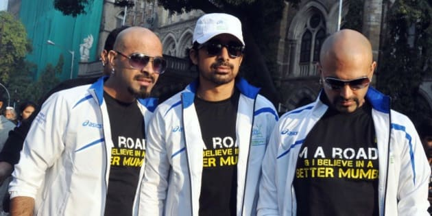 Indian Bollywood celebrity MTV Roadies pose during the Standard Chartered Mumbai Marathon (SCMM) 2012 in Mumbai on January 15, 2012.  AFP PHOTO/STR (Photo credit should read STRDEL/AFP/Getty Images)
