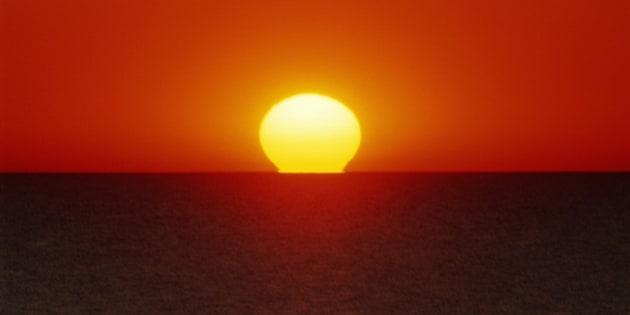 Setting sun on horizon