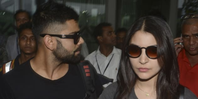 KOLKATA, INDIA - APRIL 6: Bollywood actress Anushka Sharma and Indian cricketer Virat Kohli arrive at NSCBIA, Dum Dum Airport on April 6, 2015 in Kolkata, India. Bollywood actors Hrithik Roshan, Anushka Sharma and Shahid Kapoor are set to enthrall spectators at the opening ceremony of IPL season at the Salt Lake Stadium on April 7, 2015. (Photo by Subhendu Ghosh/Hindustan Times via Getty Images)