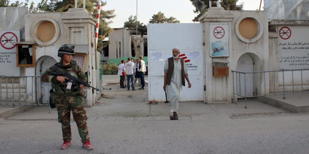 An Afghan National Army soldier stands guard at the gate of a Doctors without Borders hospital after U.S. troops left the area in Kunduz, Afghanistan, Thursday, Oct. 15, 2015. Taliban fighters took control of the key northern city late last month, leading to a protracted battle with Afghan forces supported by U.S. airstrikes. During the fighting, a U.S. air attack hit the hospital, killing at least 12 Doctors Without Borders staff and 10 patients. (AP Photo/Najim Rahim)