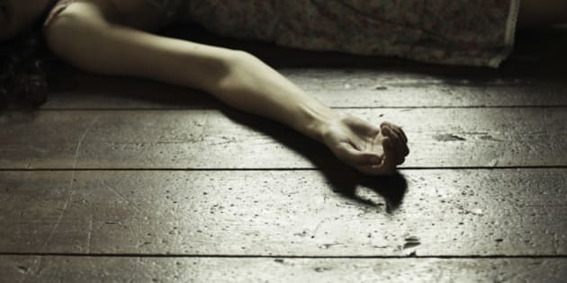 Cropped image of a woman lying on the floor