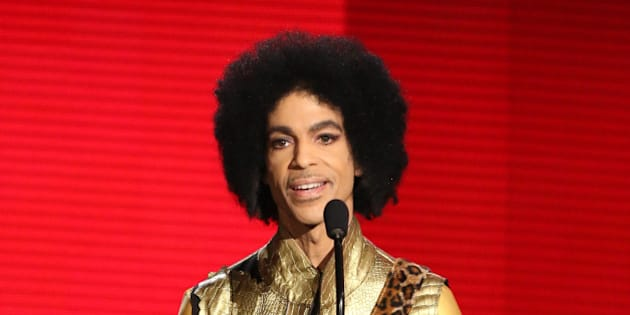 Prince presents the award for favorite album - soul/R&B at the American Music Awards at the Microsoft Theater on Sunday, Nov. 22, 2015, in Los Angeles. (Photo by Matt Sayles/Invision/AP)
