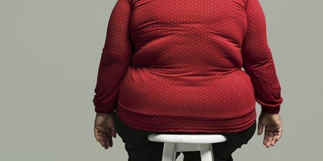 Obese woman on chair, rear view