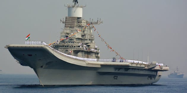 Indian Navy personnel stand on the INS Vikramaditya, a modified Kiev-class aircraft carrier, during the International Fleet Review in Visakhapatnam on February 6, 2016.  India kicked off a major display of maritime might, with ships from 50 navies converging on the country's east coast, as New Delhi seeks to boost its leadership in the region. Ninety ships including from the US, French, British and Chinese navies are taking part in the international fleet review in the Bay of Bengal -- a ceremonial inspection and parade of boats and crews.   AFP PHOTO / AFP / STR        (Photo credit should read STR/AFP/Getty Images)