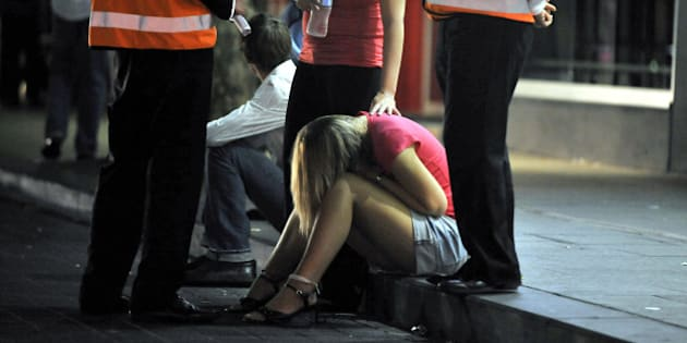 SYDNEY, AUSTRALIA - OCTOBER 12:  (EUROPE AND AUSTRALASIA OUT) An intoxicated female is attended to by a friend on the street in Kings Cross on October 12, 2008 in Sydney, Australia. (Photo by Brad Hunter/Newspix/Getty Images)