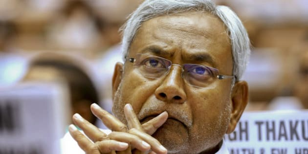 FILE- In this June 5, 2013 file photo, Bihar state Chief Minister Nitish Kumar, listens to a speaker during a conference of the chief ministers of various Indian states on Internal Security in New Delhi, India. The alliance led by Kumar defeated Indian Prime Minister Narendra Modi's ruling Hindu nationalist party in a crucial election in one of India's most populous states. (AP Photo/Saurabh Das, file)