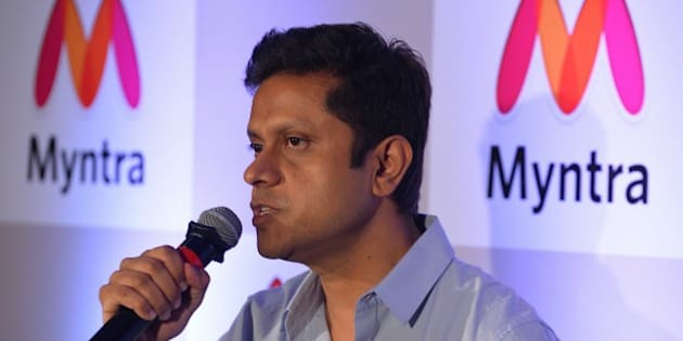 CEO of Myntra and Head of Commerce, Flipkart, Mukesh Bansal addresses the media during a press conference to announce Myntra's transition to an 'app only' platform, in Bangalore on May 12, 2015.   Myntra, e-commerce platform for fashion and lifestyle products will become a mobile app only 'etail' business from May 15, targetting 5 million app downloads in the next four months.  AFP PHOTO/ Manjunath KIRAN        (Photo credit should read Manjunath Kiran/AFP/Getty Images)
