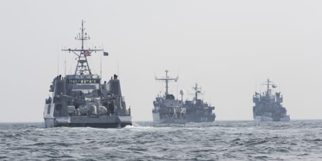 A convoy of warships is seen in the Baltic Sea along the German Coast, Germany, Tuesday, April 22, 2014. Five NATO mine-hunting ships set off on a deployment in the Baltic Sea, part of the alliance's efforts to strengthen its presence in Europe's ex-communist east as members there worry about Russia's intentions in Ukraine. The ships — a minesweeper and a support ship from Norway and one mine-hunter each from the Netherlands, Belgium and Estonia — left the German port of Kiel for an exercise. The ships will visit several Baltic ports and also participate in previously scheduled operations to dispose of ordinance from the two world wars. (AP Photo/Gero Breloer)