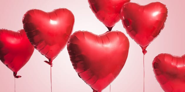 Studio shot of red heart shaped balloons