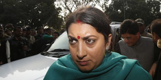 NEW DELHI, INDIA - DECEMBER 21: HRD Minister Smriti Irani comes out of the Patiala Court on December 21, 2015 in New Delhi, India. Finance Minister Arun Jaitley filed a defamation suit against Delhi Chief Minister Arvind Kejriwal and sought Rs.10 crore in damages for accusing him of corruption when he headed the DDCA. Kejriwal retorted that he and his AAP can't be intimidated. (Photo by Ravi Choudhary/Hindustan Times via Getty Images)