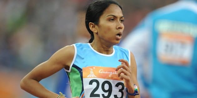 Kavita Raut of India compete in the women's 5,000m final in the athletics competition at the 16th Asian Games in Guangzhou on November 26, 2010. AFP PHOTO / FRANCOIS XAVIER MARIT (Photo credit should read FRANCOIS XAVIER MARIT/AFP/Getty Images)