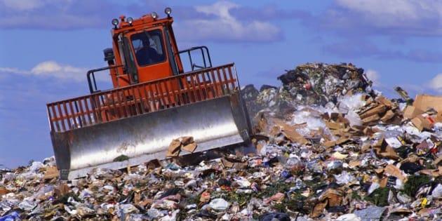 Orange Bulldozer in Landfill
