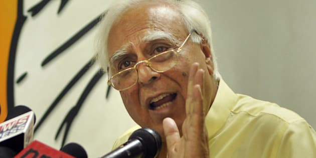 NEW DELHI, INDIA - APRIL 16: Congress leader Kapil Sibal addressing the media persons about the expenditure being spent on Narendra Modi's rally and advertisements at AICCI office on April 16, 2014 in New Delhi, India. Congress alleged that whopping Rs 5,000 is spend on poll campaign of BJP prime ministerial candidate. It claims that most of it is black money and sought a probe into the origin of these funds.  (Photo by Sushil Kumar/Hindustan Times via Getty Images)