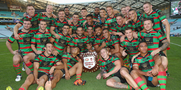 SYDNEY, AUSTRALIA - FEBRUARY 13:  The Rabbitohs team celebrate with the Charity Shield after victory during the NRL Charity Shield match between the St George Illawarra Dragons and the South Sydney Rabbitohs at ANZ Stadium on February 13, 2016 in Sydney, Australia.  (Photo by Mark Kolbe/Getty Images)