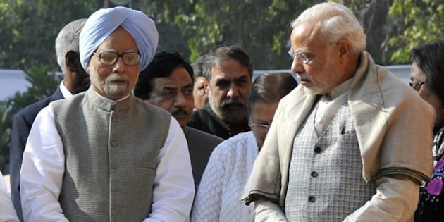 NEW DELHI, INDIA - DECEMBER 13: Prime Minister Narendra Modi and former Prime Minister Manmohan Singh during a ceremony to pay homage on the 14th Parliament attack anniversary at Parliament House on December 13, 2015 in New Delhi, India. On December 13, 2001, five terrorists had entered the Parliament House premises using a car with Home Ministry and Parliament labels and had carried out the gun attack. The attacks which had lead to the death of 7 people including six Delhi Police officials, two Parliamentary security service personnel and a gardener. (Photo by Vipin Kumar/Hindustan Times via Getty Images)