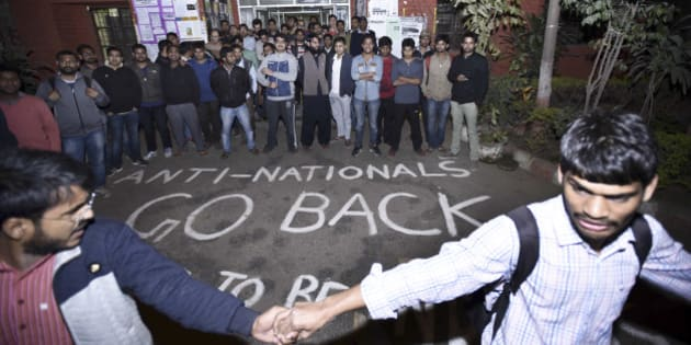 NEW DELHI, INDIA - FEBRUARY 12: ABVP Students protest against the organisers of the event on Afzal Guru where slogans were anti-national slogans were raised at JNU Campus on February 12, 2016 in New Delhi, India. JNU students union president Kanhaiya Kumar was arrested on in connection with a case of sedition and criminal conspiracy over holding of an event at the prestigious institute against hanging of Parliament attack convict Afzal Guru in 2013. A group of students on Tuesday held an event on the JNU campus and allegedly shouted slogans against India. (Photo by Arun Sharma/Hindustan Times via Getty Images)